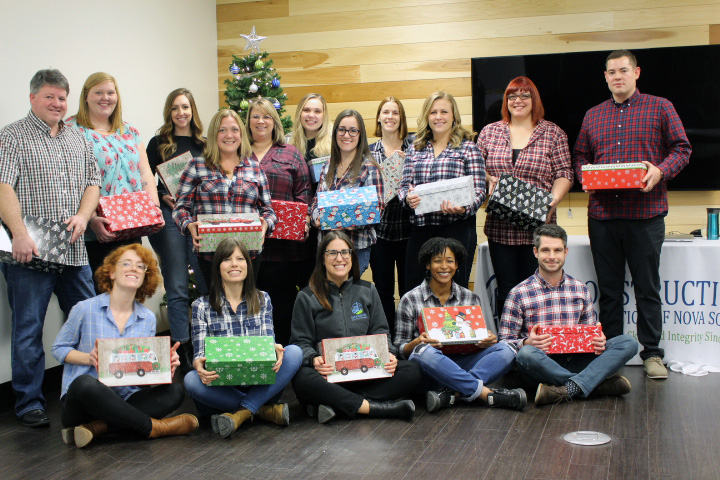 CANS Staff with their Christmas gifts prepared for the Shoebox project